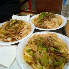 Photo taken at Xi'an Famous Foods by Laura R. on 2/9/2013