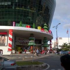 Photo taken at Suria Sabah Shopping Mall by Louis E. on 12/25/2012