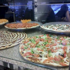 Photo taken at Valentino's Pizza by Rickie C. on 2/16/2013
