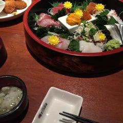 Photo taken at さくら水産 四條通麩屋町店 by Naoto T. on 6/6/2015