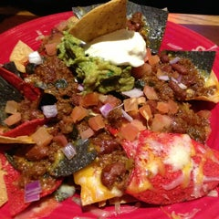 Photo taken at Red Robin Gourmet Burgers by Brian P. on 2/27/2013