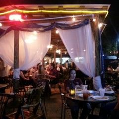 Photo taken at G'Raj Mahal Cafe by Violet B. on 3/17/2013