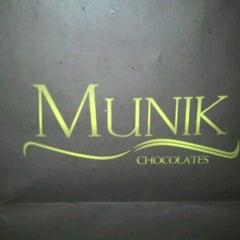 Photo taken at Munik Chocolates by Cristina L. on 10/23/2012