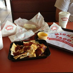 Photo taken at Mighty Taco by Lindsay R. on 8/11/2013