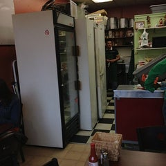 Photo taken at Malena's Taco Shop by Dave R. on 12/29/2012