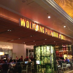 Photo taken at Wolfgang Puck Bar & Grill by Juan F. on 12/30/2012