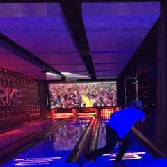 Photo taken at Strike Bowling Bar by Deborah T. on 12/28/2014