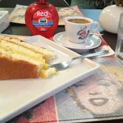 Photo taken at Caffè Olé Bistrô by Priscila (. on 2/24/2013