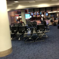 Photo taken at Terminal 4 by Mark R. on 11/7/2012