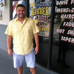 Photo taken at Carl's Barber Shop by Carlos G. on 5/12/2013
