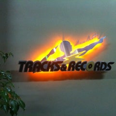 Photo taken at Usain Bolt's Tracks & Records by Emrah G. on 10/15/2012