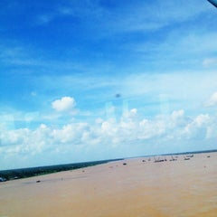Photo taken at Cầu Mỹ Thuận by Kimmy L. on 7/4/2014