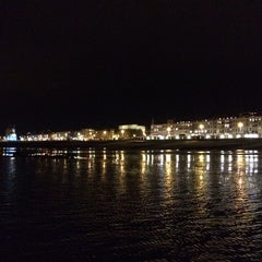 Photo taken at Hastings Pier by Romeo T. on 10/25/2014