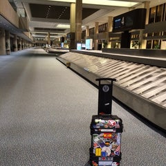 Photo taken at Baggage Claim by Glenn F. on 4/18/2014