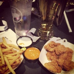 Photo taken at Buffalo Wild Wings by Lisa S. on 1/11/2013