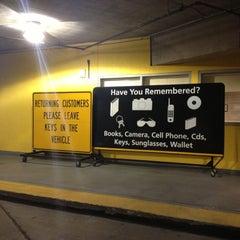 Photo taken at Hertz Rental Car by Eric A. on 12/8/2012