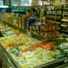 Photo taken at Farmer Joe's Marketplace by Lil M. on 5/5/2013