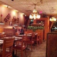Photo taken at Grape Leaves Restaurant by Amanda E. on 10/19/2013