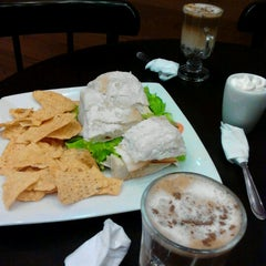 Photo taken at Café Donuts by Cristiana D. on 12/14/2012