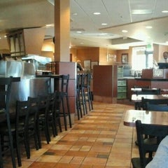 Photo taken at Amici's East Coast Pizzeria by Stella B. on 11/19/2012