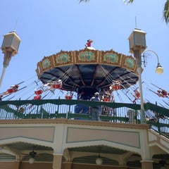 Photo taken at Silly Symphony Swings by Kate I. on 6/15/2013