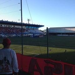 Photo taken at Estádio Passo D'Areia (Zequinha) by Luiza A. on 12/22/2012