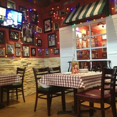 Photo taken at Buca Di Beppo by Alejandro A. on 1/31/2013