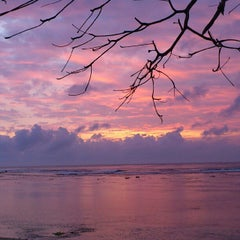 Photo taken at Pantai Ujung Genteng by Enny Nur R. on 10/5/2012