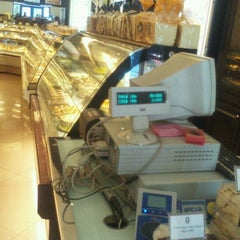 Photo taken at Holland Bakery by Jonathan P. on 9/18/2012
