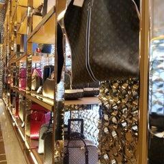 Photo taken at Louis Vuitton by Katie O. on 12/30/2012