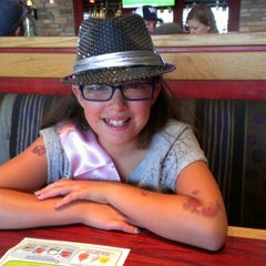 Photo taken at Red Robin Gourmet Burgers by Marisa M. on 7/18/2012