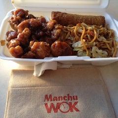 Photo taken at Manchu Wok by Erik P. on 6/8/2012