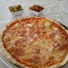 Photo taken at Restaurante Pizzería Isoletta by Nacho G. on 8/28/2011