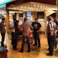 Photo taken at Transis HQ by Justin H. on 12/5/2012