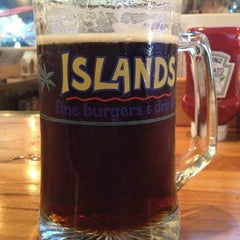 Photo taken at Islands Restaurant by Carlos A. on 6/22/2013
