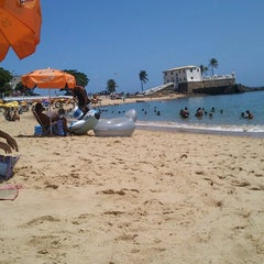 Photo taken at Praia do Porto da Barra by Tiago A. on 3/13/2013