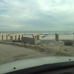 Photo taken at Rockaway Beach by Roberto C. on 11/16/2012