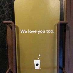 Photo taken at Starbucks by Simon S. on 12/8/2012