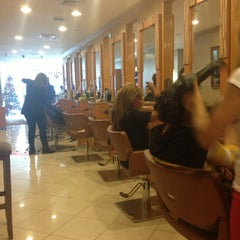 Photo taken at Rizo's Beauty Salon by Jennifer J. on 12/22/2012