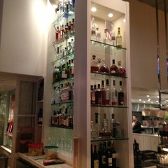 Photo taken at Wolfgang Puck Bar & Grill by Brian B. on 2/26/2013