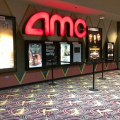 Photo taken at AMC River East 21 by Candice K. on 11/11/2012