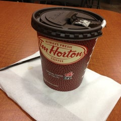 Photo taken at Tim Hortons by Junia G. on 10/28/2012