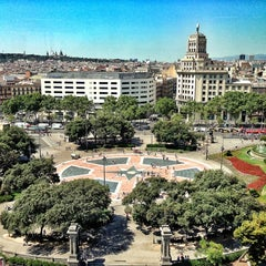 Photo taken at Plaça de Catalunya by Dmitry on 7/15/2013