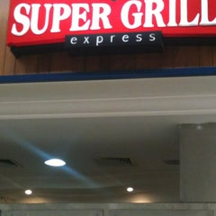 Photo taken at Super Grill Express by Isabel on 11/3/2012