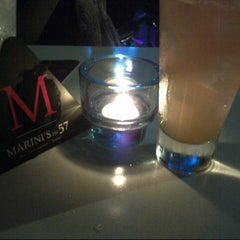 Photo taken at Marini's on 57 by Valentine A. on 2/24/2013