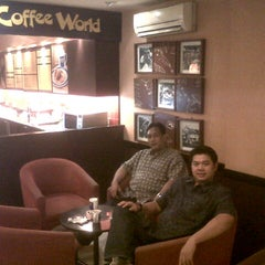 Photo taken at Coffee World by DODI B. on 12/21/2012