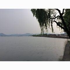 Photo taken at 白堤 Bai Causeway by zhang w. on 5/20/2015
