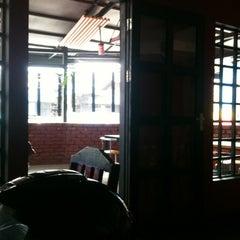 Photo taken at Cozy Café by Ryan I. on 11/3/2012