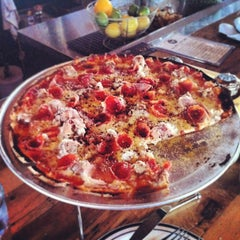 Photo taken at Eno's Pizza Tavern by Adam D. on 7/22/2013