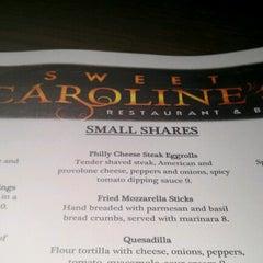 Photo taken at Sweet Caroline's Restaurant & Bar by Cassi J. on 11/27/2012